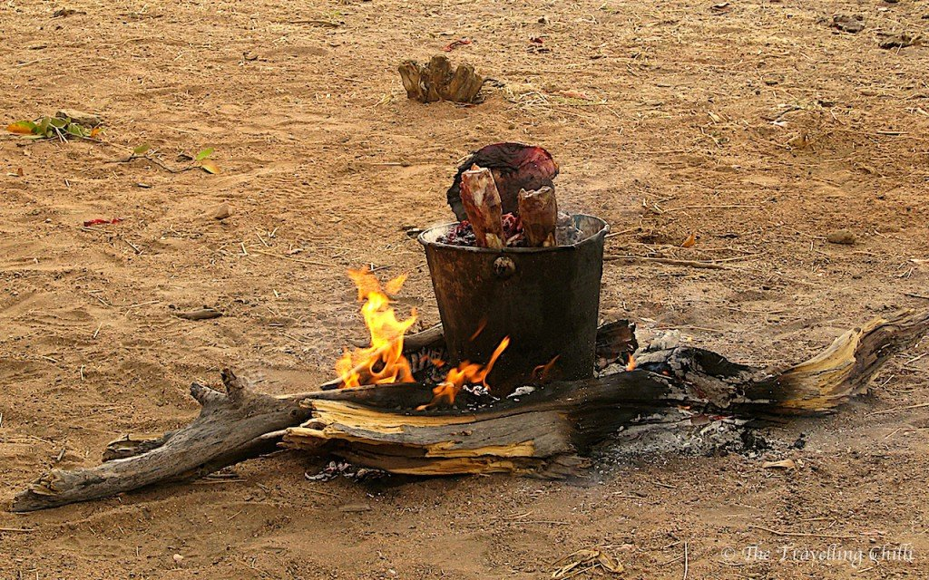 Himba Namibia cooking meat