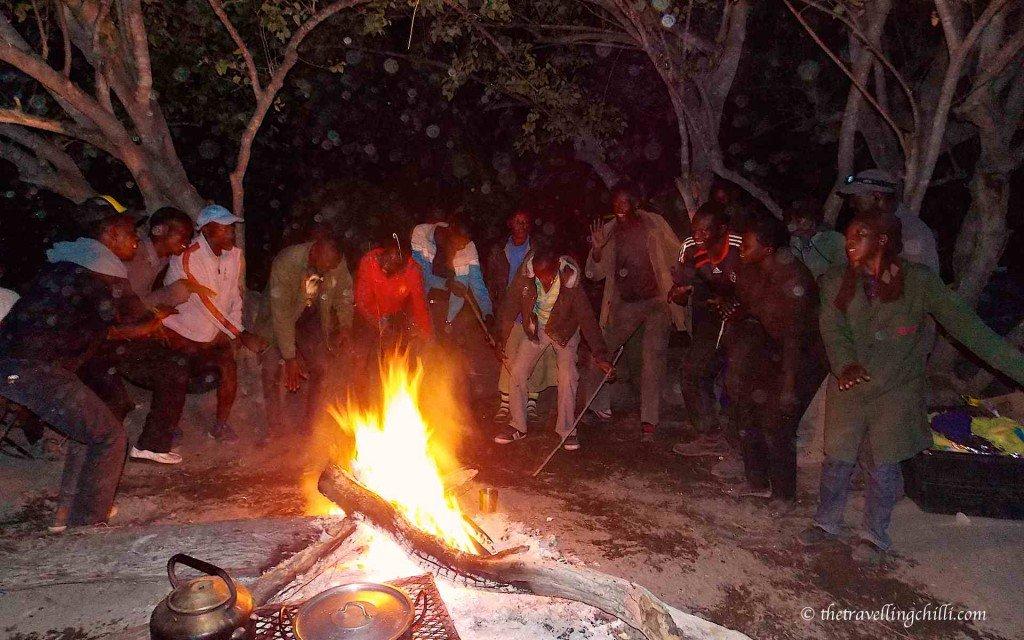 botswana delta okavango dancing people campfire