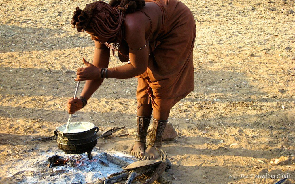Himba woman cooking Namibia