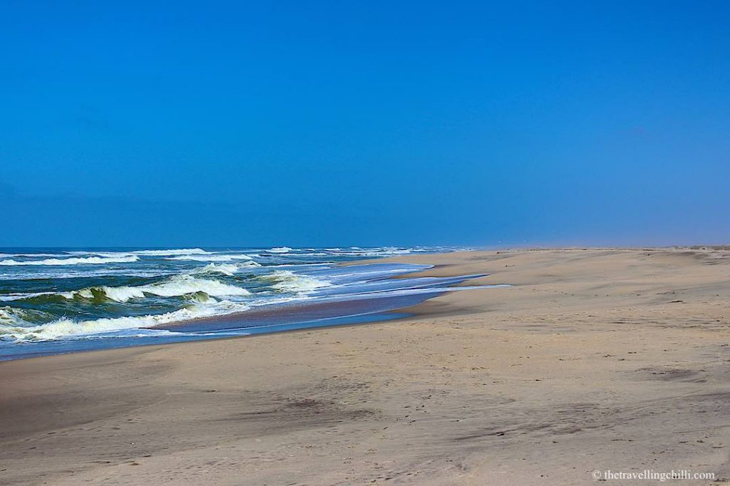 Skeleton coast in Namibia where the white sand of the desert touches the Atlantic ocean