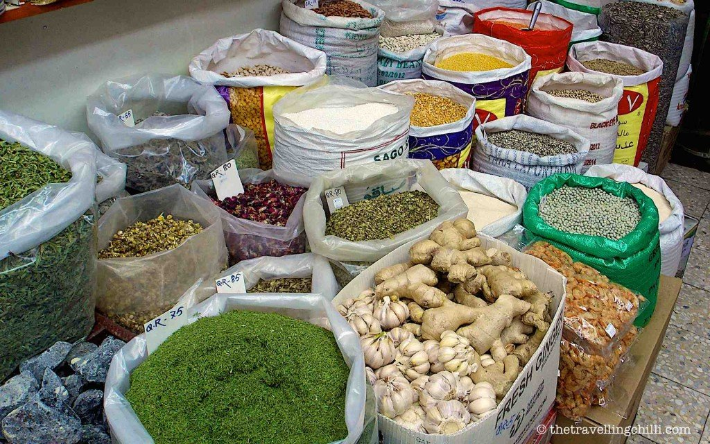 Shop in Souq waqif with bags of spices, herbs and dried fruits