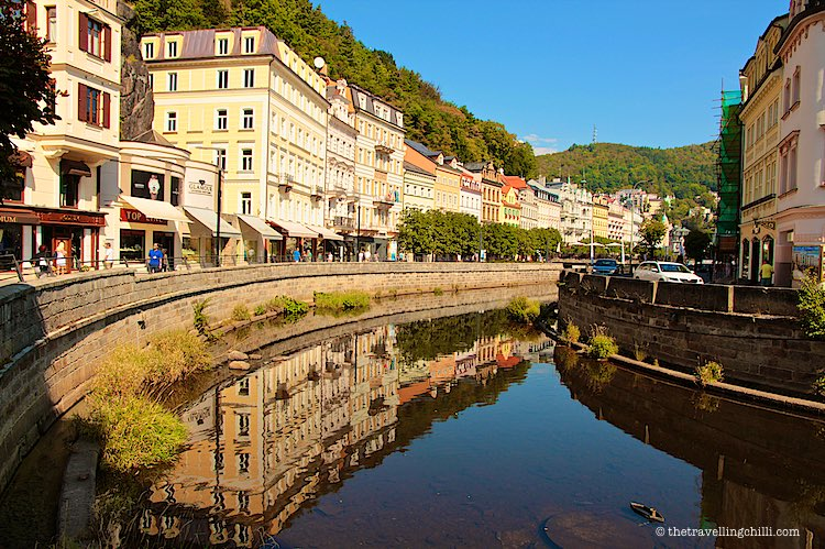 Reflection of colourful houses in river Tepla in Karlovy Vary Czech Republic | Karlovy Vary spa