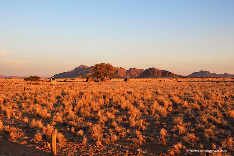 Camping at Sossus Oasis campsite in the desert landscape of Namibia at Sossusvlei