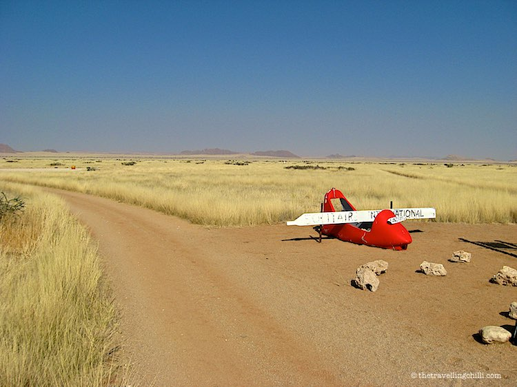 Solitaire International Airport Namibia with broken red plane and yellow grass