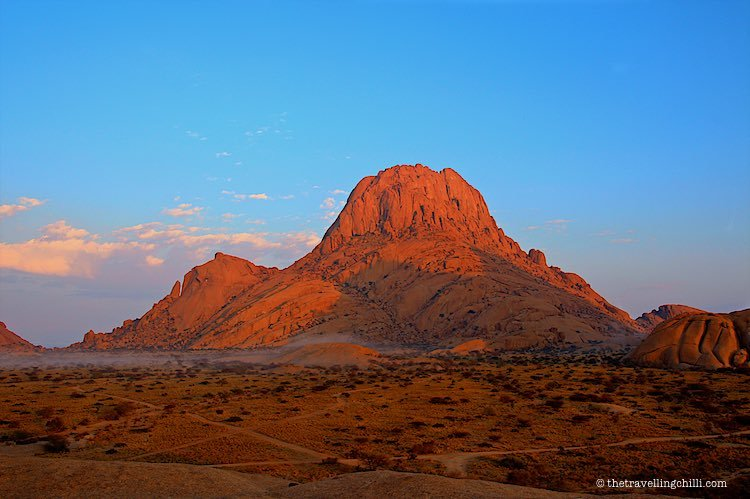 Red granite outcrops in Spitzkoppe community in Namibia during sunrise