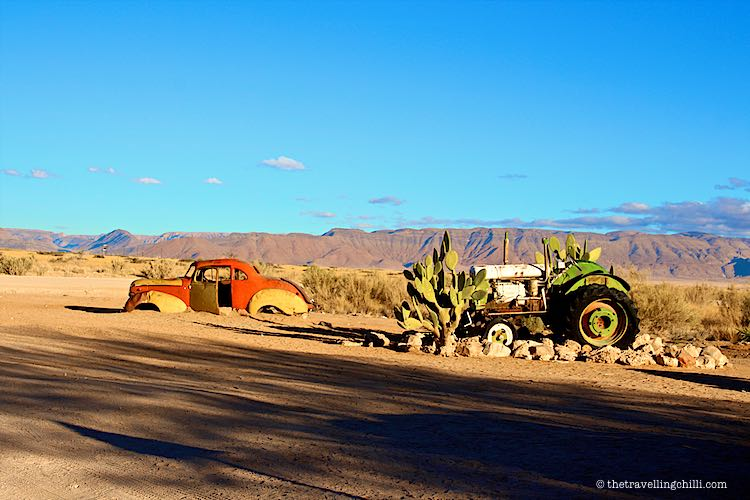 Vintage car wrecks in the desert by Solitaire Namibia