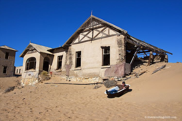 taking a bath in the sand of the ghosttown of Kolmanskop in Luderitz