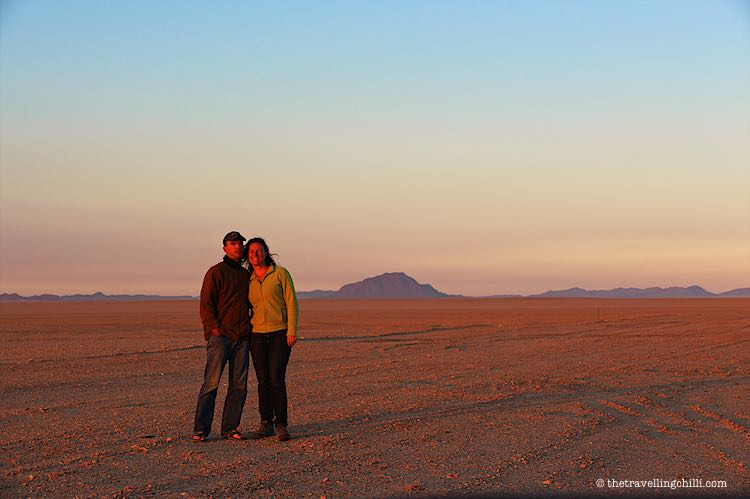 The Travelling Chilli standing in the sunset of the Namibia scenery