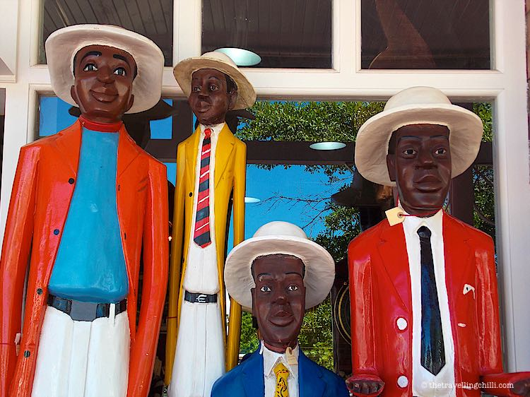 colourful wooden statues colonial figures as souvenirs from cape town
