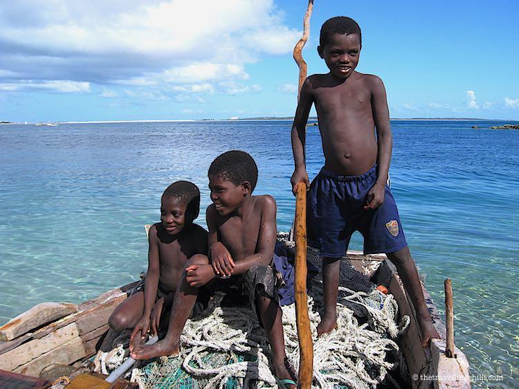 3 boys on a boat in Bazaruto Archipelago Mozambique