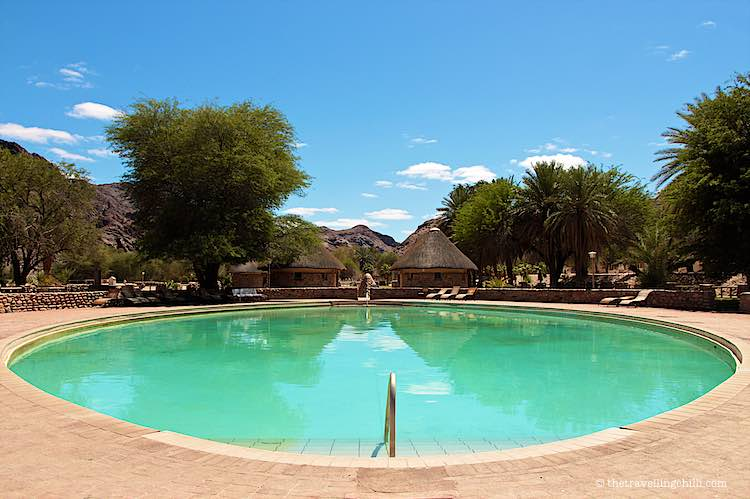 Hot springs pool with palm trees in Ai Ais campsite at the mouth of the Fish River Canyon