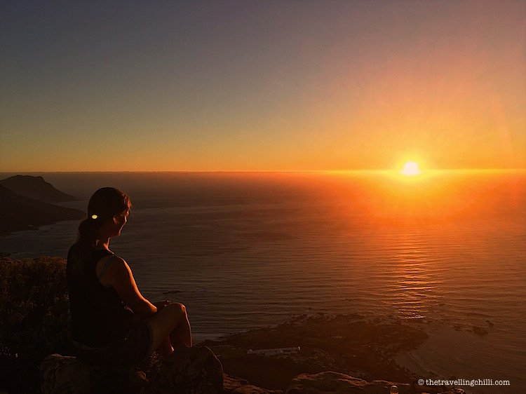 Watching the sunset in Cape Town on top of Lion's Head overlooking the ocean in Cape Town South Africa | Cape Town sunset from the top of Lion's Head