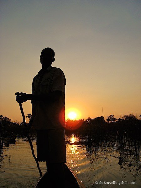 Mokoro poler sunset ride in the Okavango Delta in Botswana