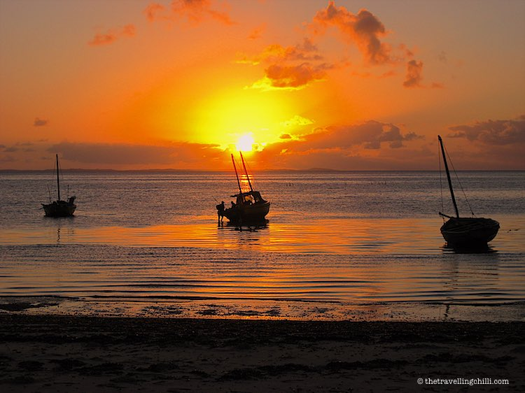 Sunrise overlooking the Bazaruto Archipelago in the distance in Mozambique with local dhow boats