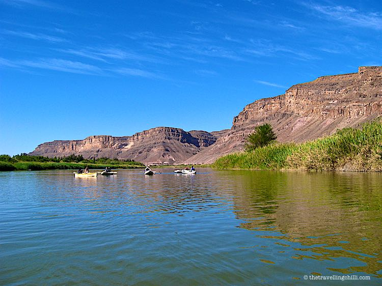Kayaking on the Orange river between Namibia and South Africa with the desert mountains | Gariep river kayaking