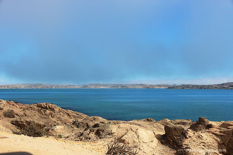 Shark Island campsite in Luderitz with views of Namibia mainland over the Atlantic Ocean