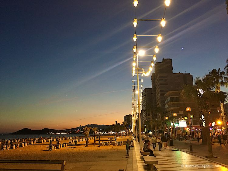 Benidorm promenade by night with lights on the Playa Levante Beach