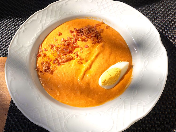 Salmorejo from Andalucia is a cold soup with ripe tomatoes, bread and garlic with hard boiled egg is Spanish Food dish
