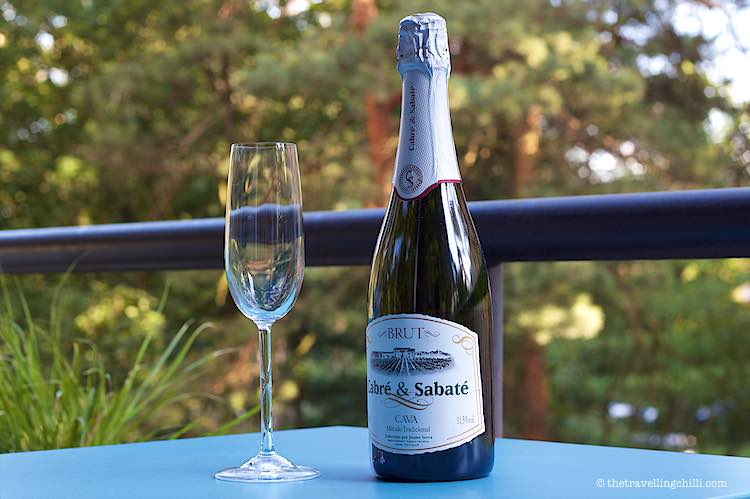 Bottle of Spanish cava with a cava glass brut from Cabre y Sabate