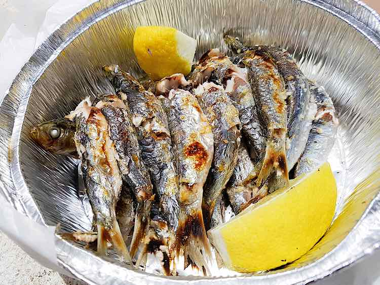 Grilled sardines or grilled fish from the Costa Tropical in Spain are grilled over an open fire