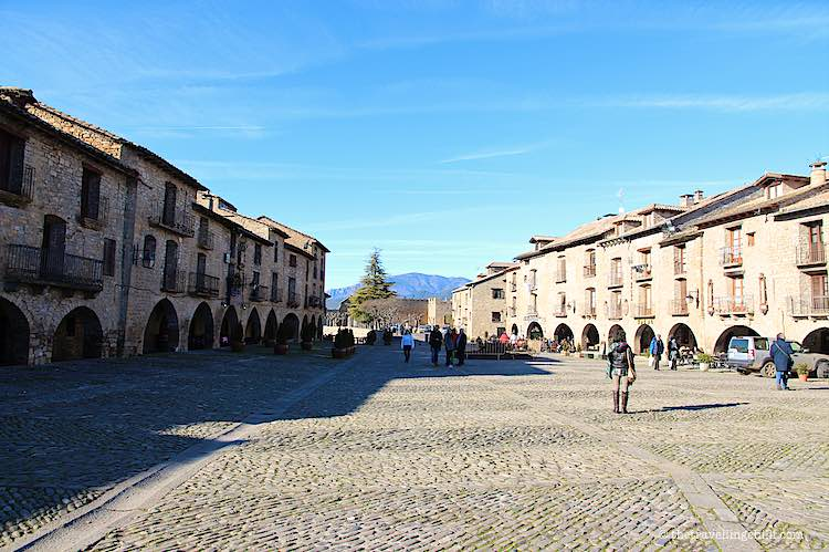 Plaza Mayor in Aínsa with the Spanish Pyrenees in the background