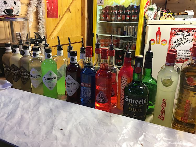Line up of bottled of old jenever and fruit jenever at Christmas market in Genk
