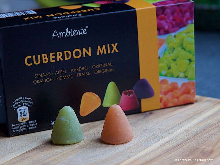 Cuberdon candy are purple with goey filling but also come in different colours like green and yellow