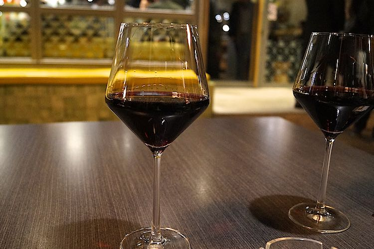 Two glasses of Red Rioja wine on a dark wooden table