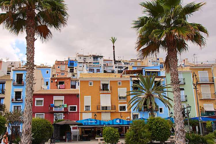 Colourful painted houses on main square in Villajoyosa