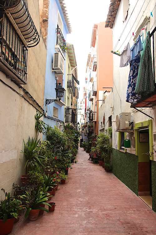 Narrow streets with colourful houses and plants in old town Villajoyosa