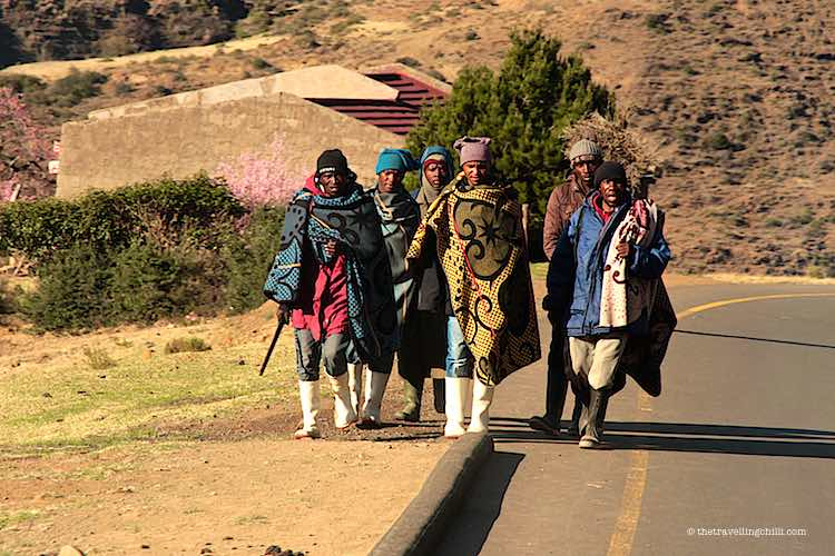 Men on the road wearing basotho blankets against the cold