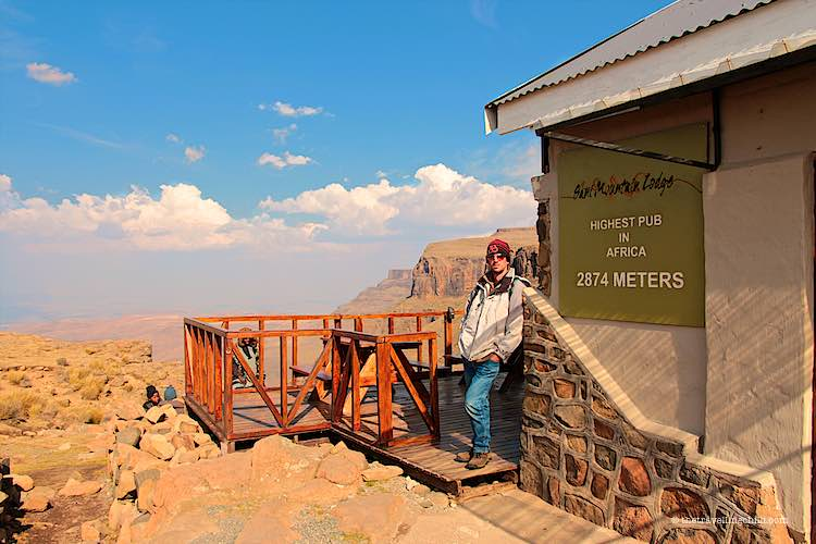 Man standing on top of the Sani pass at the highest pub in Africa