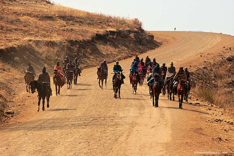 Group of basotho men on horses on a gravel road in Lesotho