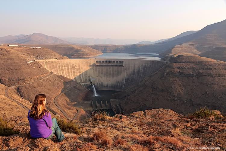 Woman sitting overlooking the Katse dam in Lesotho