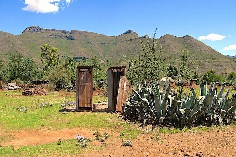 wooden toilet in Malealea in lesotho separate for men and women with a view